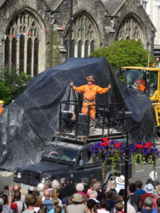 Will Coleman 'The Teazer' revving up the crowds: the Man Engine under wraps in the background